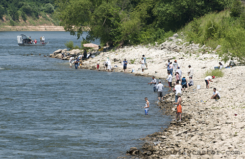 Crowded shores along the Red River at Denison Dam