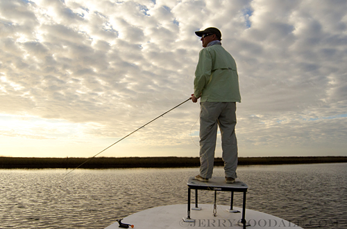 On Deck watching for signs of Louisiana redfish
