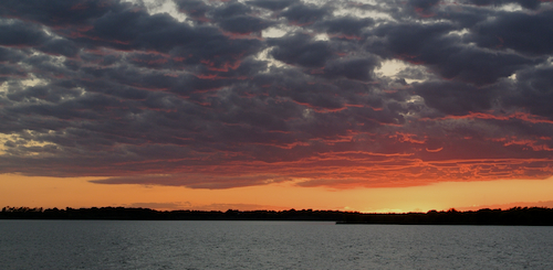 Dramatic Sunset on Lake Ray Roberts Texas a day after dangerous spring weather.