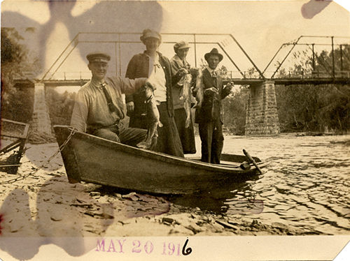 Antique photography of people and fish