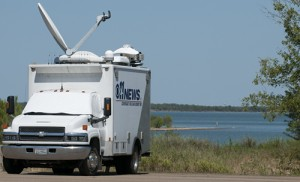 News Media on Lake Ray Roberts recording the news of zebra mussels 2012.