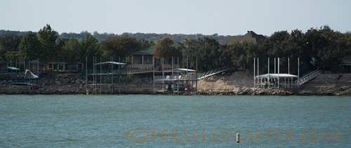 Private docks high and dry at Lake Bridgeport, Texas.