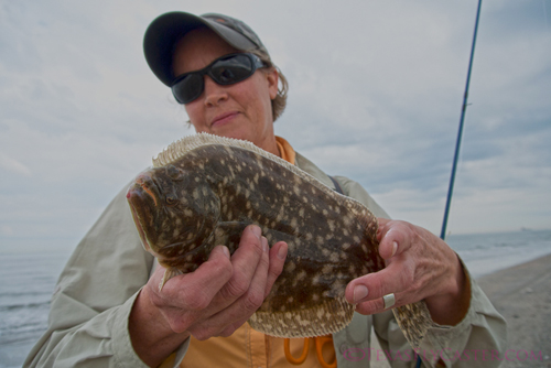 One of my guests Leslie Kregel with her flounder caught in Galveston, TX