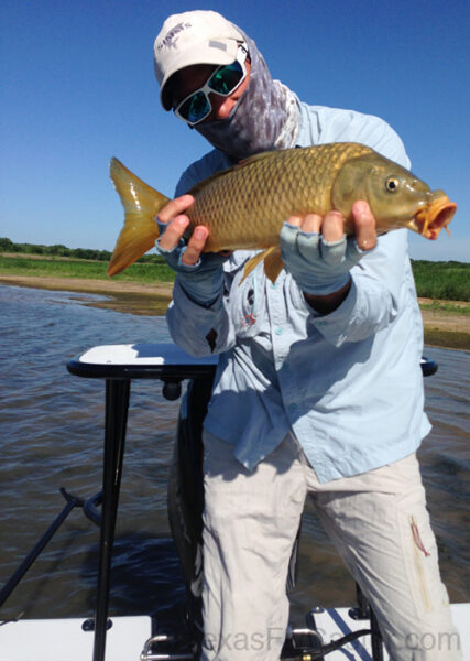 fly fishing for carp off East Cape Skiff