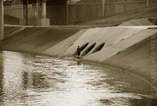 Brays Bayou along the concrete creek banks